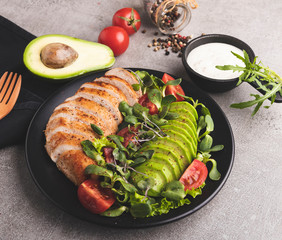 Fototapete - roasted sliced chicken fillet with avocado, tomatoes, sunflower sprouts on  plate healthy food