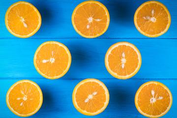Foto op Canvas Vruchten .cut oranges on a blue wooden background