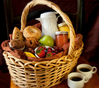 Breakfast Basket with Bagels, Muffins, Scones, Fruit, Coffee, and Juice for breakfast in Bed