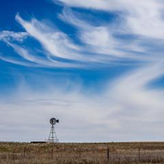 Wind Turbine On Land Against Sky