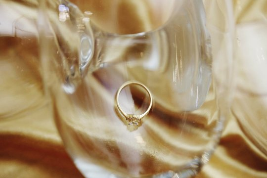Close-up Of Wedding Ring In Wineglass