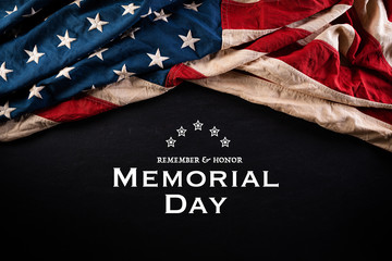 Happy Memorial Day. American flags with the text REMEMBER & HONOR against a blackboard background. May 25.