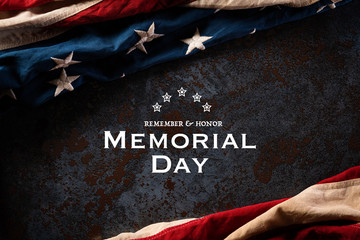 Happy Memorial Day. American flags with the text REMEMBER & HONOR against a black stone texture...