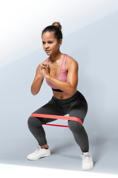 Woman doing a butt workout with a resistance band mockup