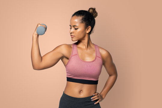 Fit woman working out with dumbbell mockup