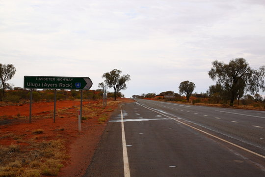Lasseter highway Road Sign to Uluru Ayers Rock in outback central Australia.