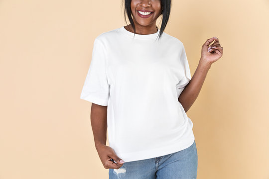 Woman wearing a blank white t-shirt and jeans