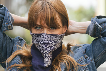 Woman using a scarf as a face mask during coronavirus outbreak