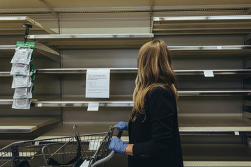 Wall Mural - Empty shelves at the supermarket due to COVID-19 panic
