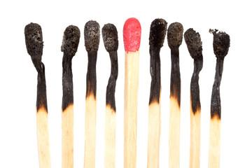 Burned matches over white