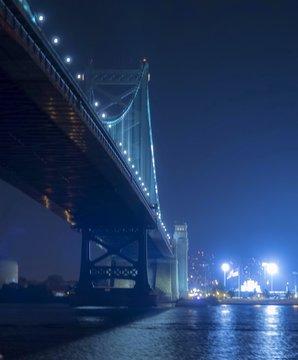 Benjamin Franklin Bridge Over Delaware River Against Sky At Night
