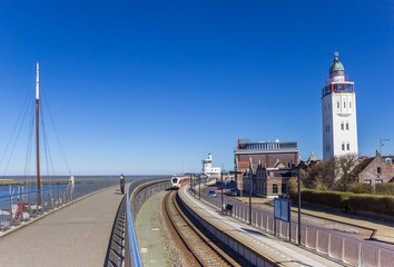 Fototapete - Railroad track and lighthouse in the harbor of Harlingen, Netherlands
