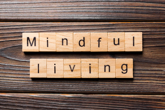 mindful living word written on wood block. mindful living text on table, concept