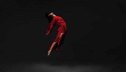 Contemporary dancer dancing on studio background