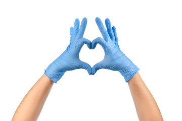 Doctor's hands in medical gloves in shape of heart on white background.