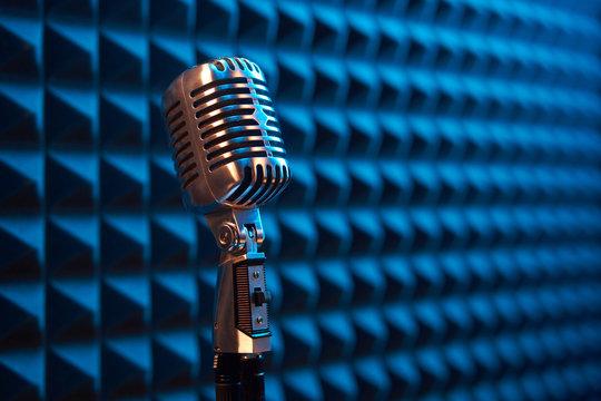 Studio retro condenser microphone on acoustic foam panel