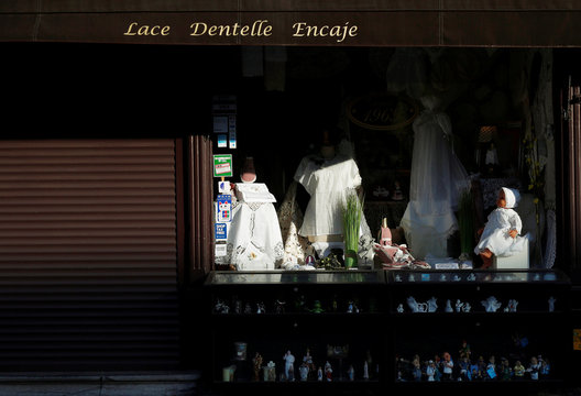 A closed lace shop is seen in Bruges amid coronavirus disease (COVID-19) outbreak