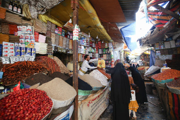 People shop for spices during preparations for the holy month of Ramadan amid concerns of the spread of the coronavirus disease (COVID-19), in Sanaa