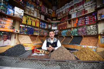 A spices vendor recites the Quran as he waits for customers during preparations for the holy month of Ramadan amid concerns of the spread of the coronavirus disease (COVID-19), in Sanaa