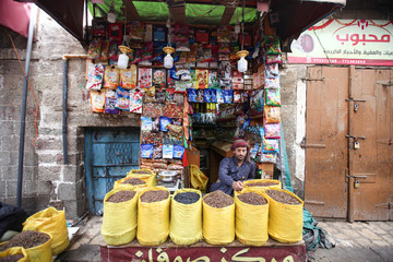 A spices vendor waits for customers during preparations for the holy month of Ramadan amid concerns of the spread of the coronavirus disease (COVID-19), in Sanaa