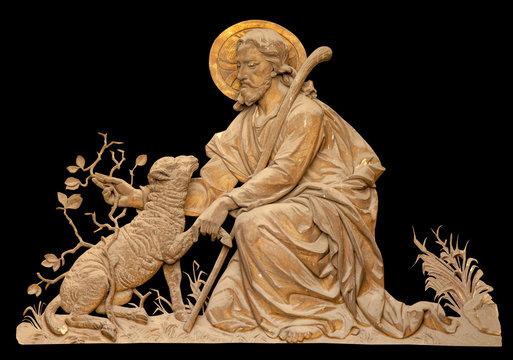Antique statue of Jesus Christ Good Shepherd. Fragment of ancient sculpture. Horizontal image.