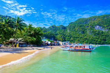 Wall Mural - Harbour of El Nido Town with boats at beautiful beach, Palawan Island, Philippines