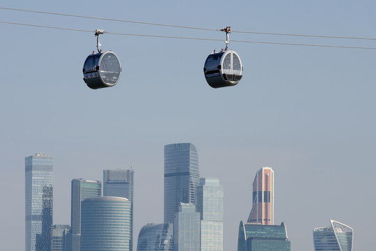 Cable cars above Moscow river and skyscrapers of Moscow city. Moscow, Russia.
