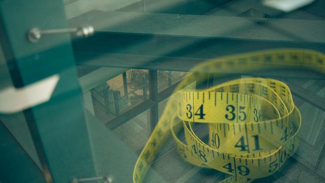 Measure Tape Seen Through Glass