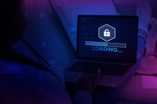 Unrecognizable hacker using laptop with progress loading bar