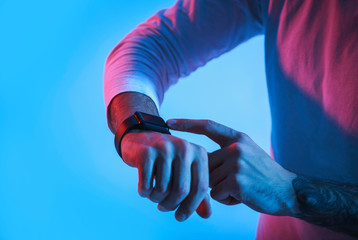 Modern technology for people. Man controls smartwatch
