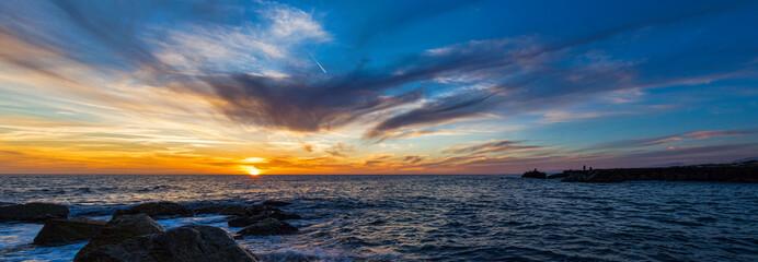 Fototapeta Seascape Against Cloudy Sky At Dusk