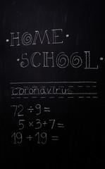 Home school lesson written on a bedroom chalkboard wall.