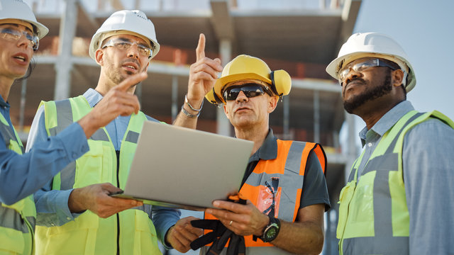Diverse Team of Specialists Use Laptop Computer on Construction Site. Real Estate Building Project with Civil Engineer, Architectural Investor, Businesswoman and Worker Discussing Blueprint Plan