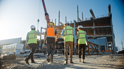 Diverse Team of Specialists Inspect Commercial, Industrial Building Construction Site. Real Estate...