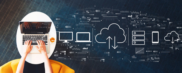 Cloud computing with person using a laptop on a white table Wall mural