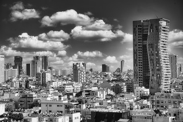 Fototapete - Magnificent Cityscape of Tel Aviv, in Israel in Black and White under a dramatic Sky.