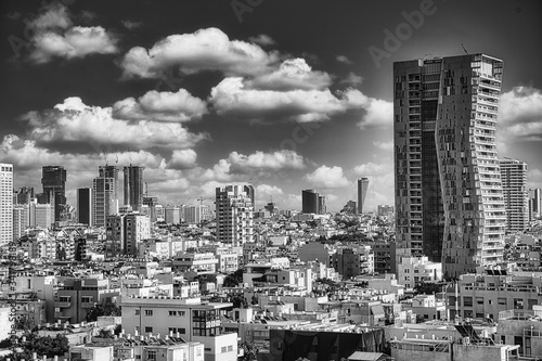 Wall mural Magnificent Cityscape of Tel Aviv, in Israel in Black and White under a dramatic Sky.