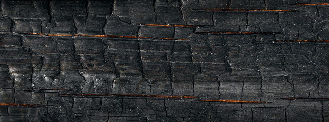 Burnt board background and texture. Panorama. Banner.