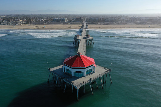Huntington Beach Pier on the Pacific Ocean is empty at sunrise on the 50th anniversary of Earth Day, as the global outbreak of coronavirus disease (COVID-19) continues, in Huntington Beach