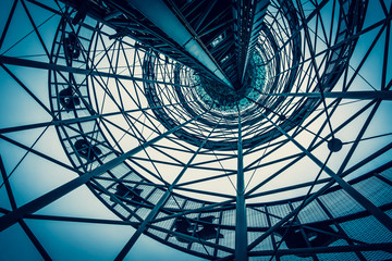 Steel structure of the observation tower in Batumi. Iron pipes create a futuristic image of the structure. Web of metal. View from the bottom up. Day Cloudy. Fotomurales