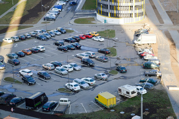 View from the top of a large open car parking and indoor multi-level parking in a residential area of the big city of the metropolis Fototapete
