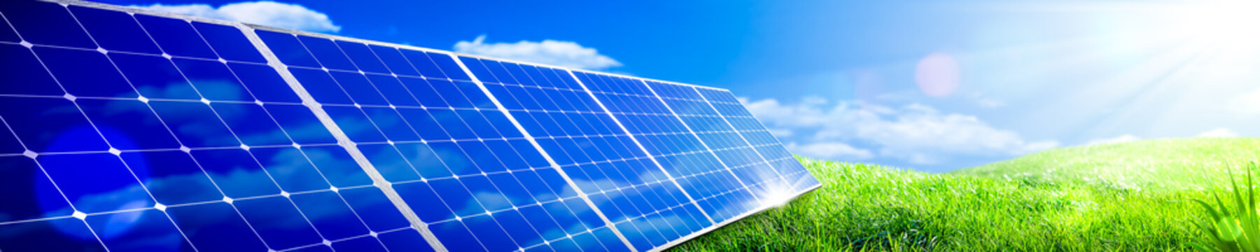 Banner Of Solar Panels In Green Grass Landscape With Blue Sky And Sunlight - Clean Energy Concept