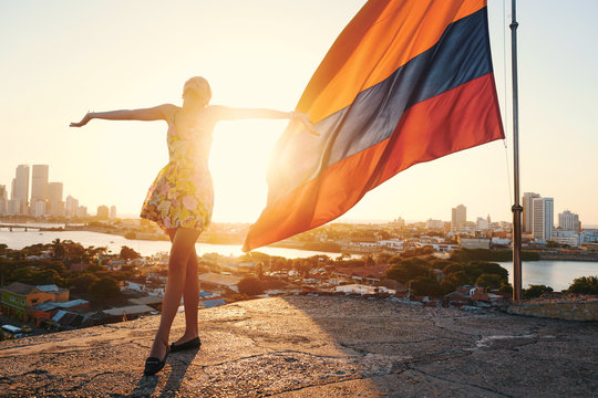 colombian flag and girl in golden and optimist sunshine full of patriot