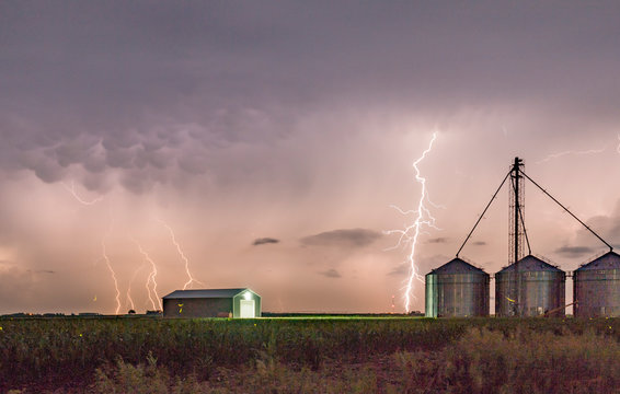 Dramatic Lightning Storm Over a Farm on the Great Plains During Summertime