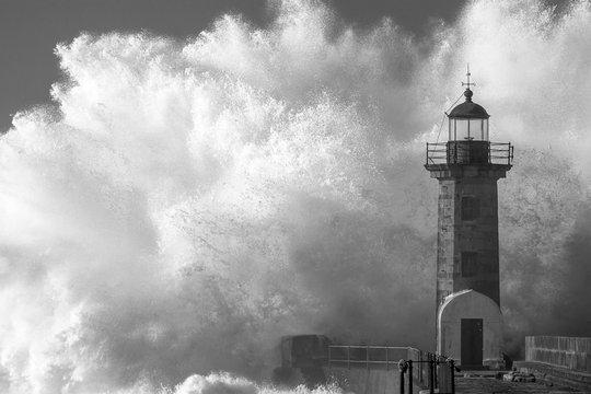 Majestic Wave Splashing On Lighthouse During Storm