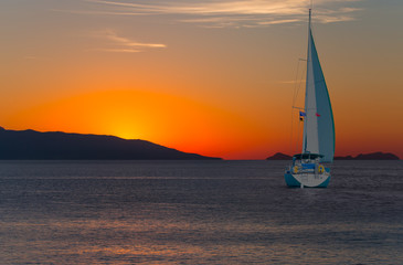 Wall Mural - Yacht in the Mediterranean sea at amazing sunset