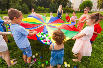 Cheerful children playing outdoors at birthday party Fotomurales