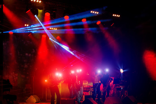 Illumination and lighting effects during a concert of a rock music band.