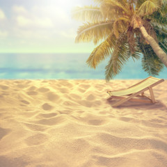 Fototapete - Summer sandy beach with blurred sea background and beach chair and coconut tree  Montage of summer relaxation background