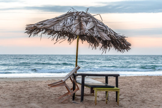 Photo of vacant beach shack made up of dried coconut leaves on a deserted beach of tropical island during sunset amidst the complete lockdown in the wake of COVID-19 virus causing pandemic. - Image.